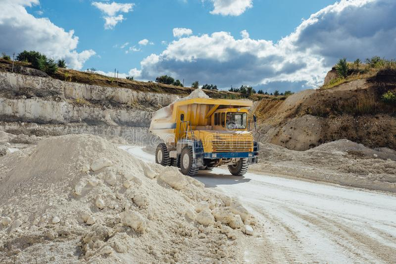 Chalk quarry. Moving dump truck loaded with chalk.  stock images
