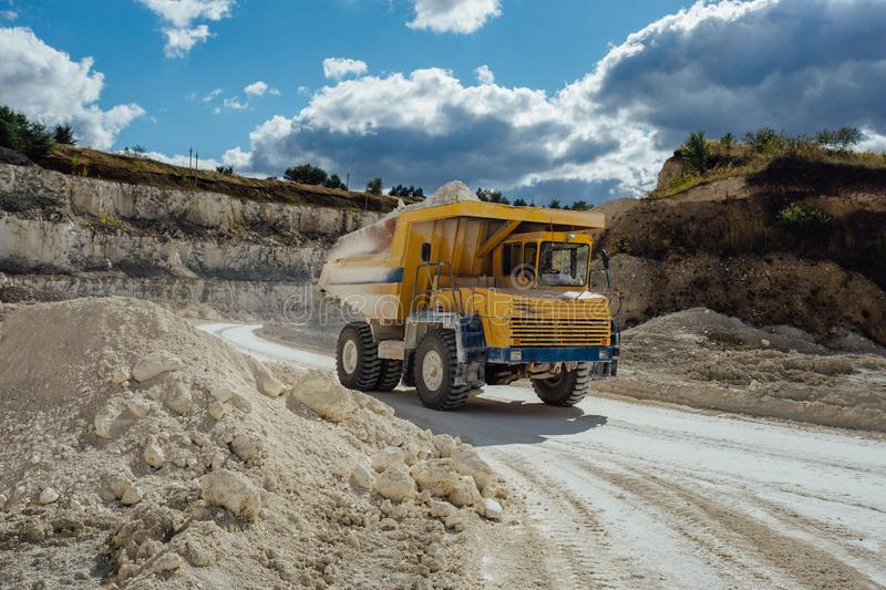 Chalk quarry. Moving dump truck loaded with chalk.  stock photography