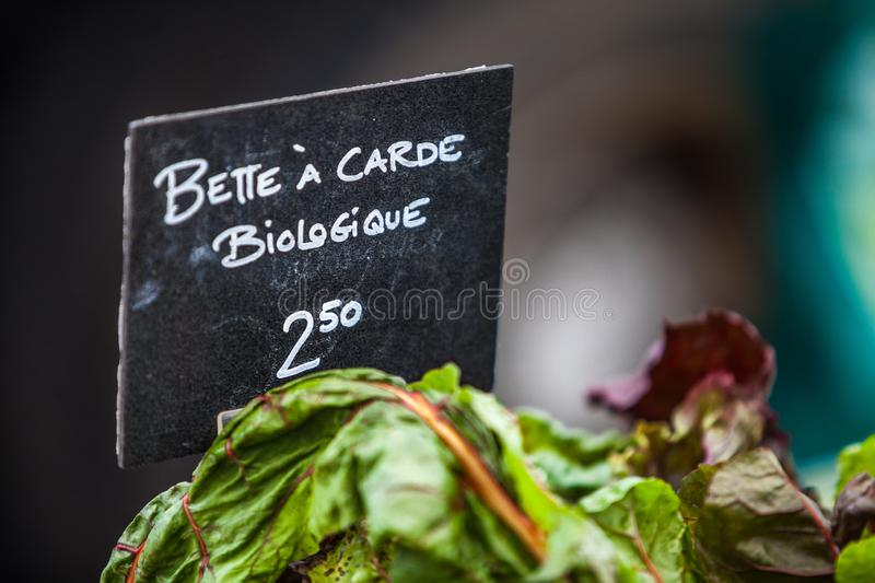 Chalk sign selling organic swiss chard under the name bette � carde biologique stock image