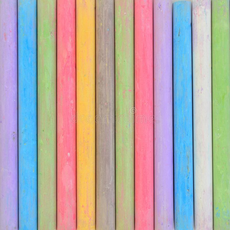 Chalk sticks. Colorful chalk sticks in a row stock photo