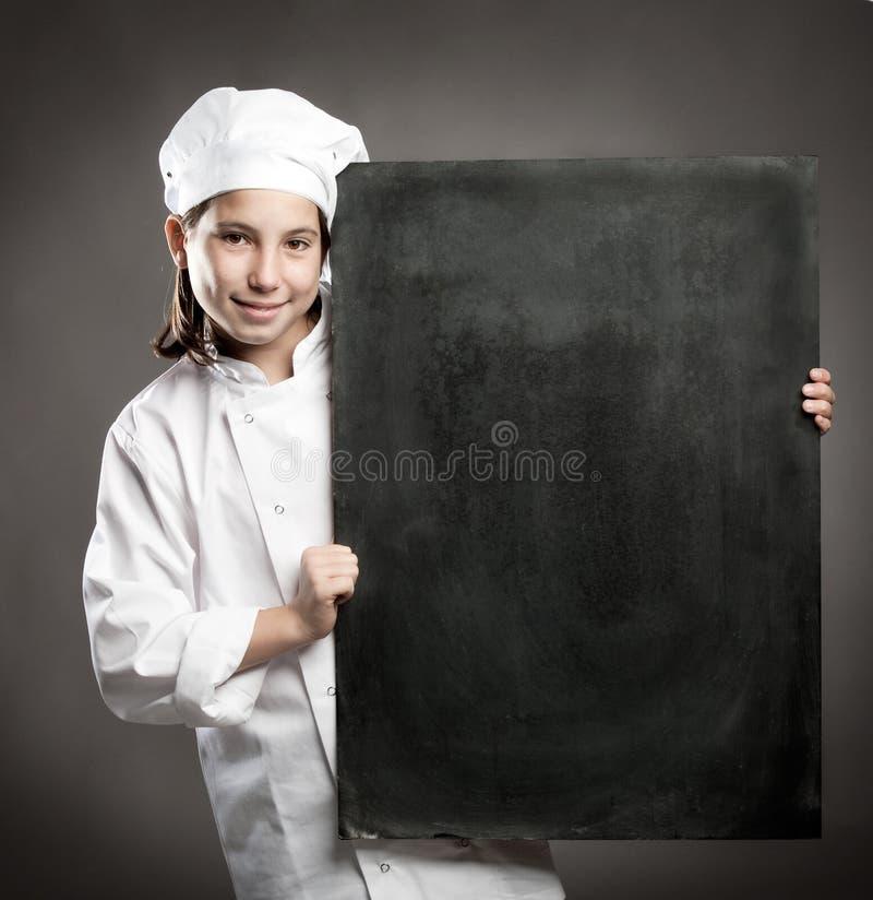 Chalkboard удерживания шеф-повара стоковое фото rf