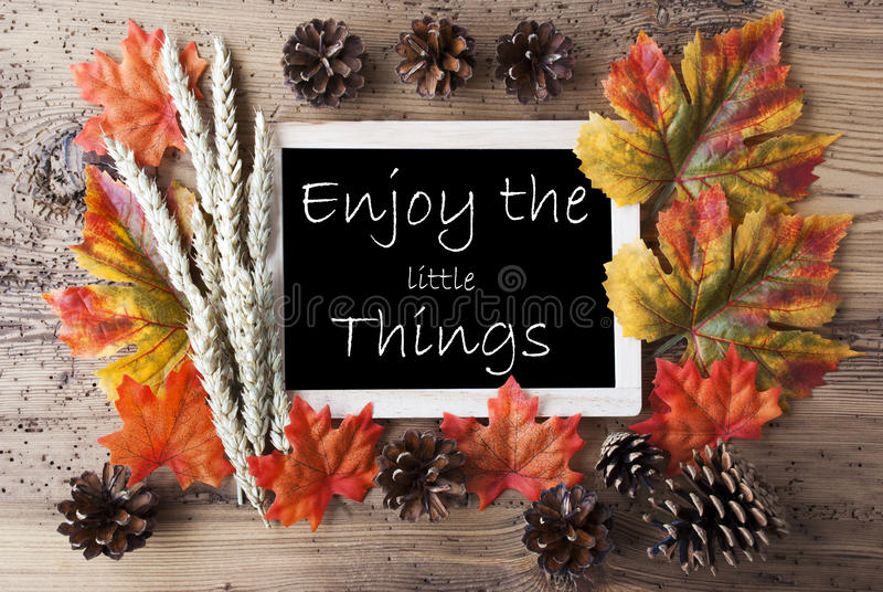 Chalkboard With Autumn Decoration, Quote Enjoy The Little Things royalty free stock photos