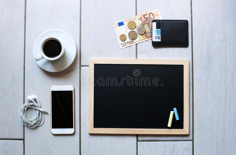 Chalkboard or Blackboard ready for text. Education or working, business, job concept. Stylish office background with coffee, wallet with euro money, mobile royalty free stock photo