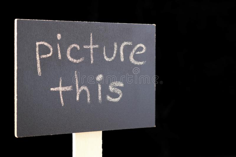 Picture This - chalkboard sign on black background. Chalkboard or blackboard sign with `picture this` text - good for social media posts, blogs, internet stock photo