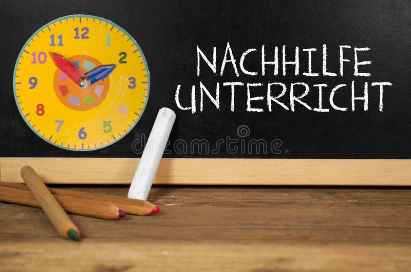 Chalkboard with the german word for private tuition - Nachhilfeunterricht royalty free stock images