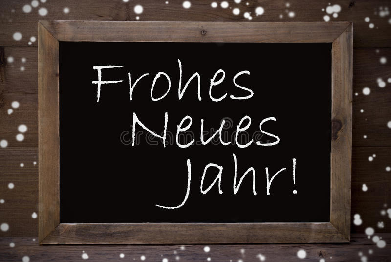 Chalkboard With Frohes Neues Jahr Mean New Year, Snowflakes. Brown Blackboard With German Text Frohes Neues Jahr Means Happy New Year As Christmas Greeting Card stock photo