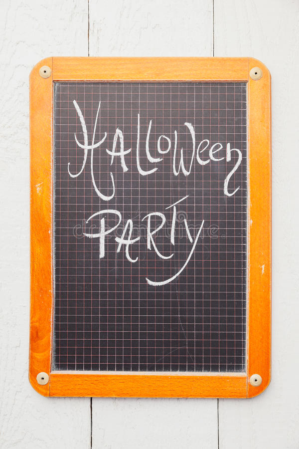 Chalkboard, Halloween Party. Chalkboard with handwritten Halloween Party text royalty free stock photo