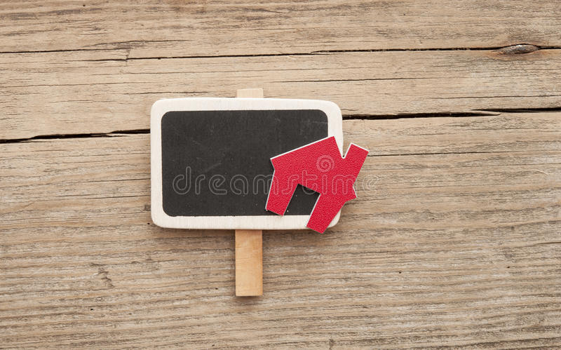 Chalkboard with house shaped sign stock photography