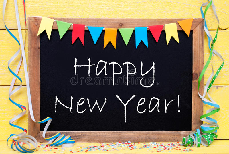 Chalkboard With Party Decoration, Text Happy New Year. Chalkboard With English Text Happy New Year. Party Decoration Like Streamer, Confetti And Bunting Flags royalty free stock photography