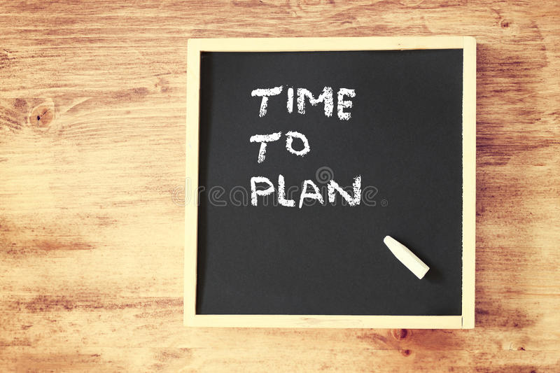 Chalkboard with the phrase time to plan stock photo