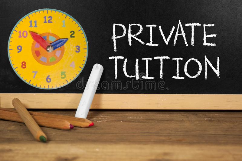 Chalkboard with private tuition stock image