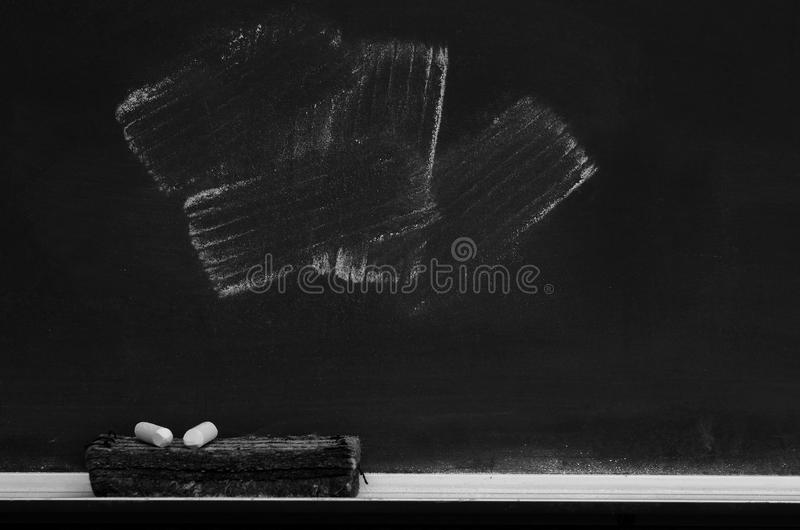 Chalkboard in School for Education With Eraser and Chalk Board. Chalkboard in school for education with eraser and chalk writing stock photos