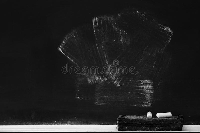 Chalkboard in School for Education With Eraser and Chalk Board. Chalkboard in school for education with eraser and chalk writing royalty free stock images