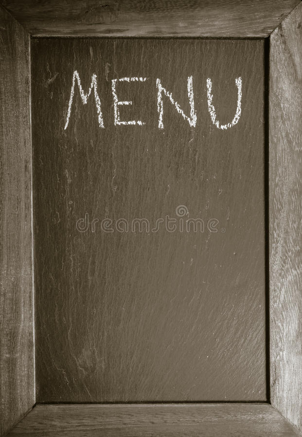 Chalkboard with wooden frame for restaurant with written text menu layout template background stock image