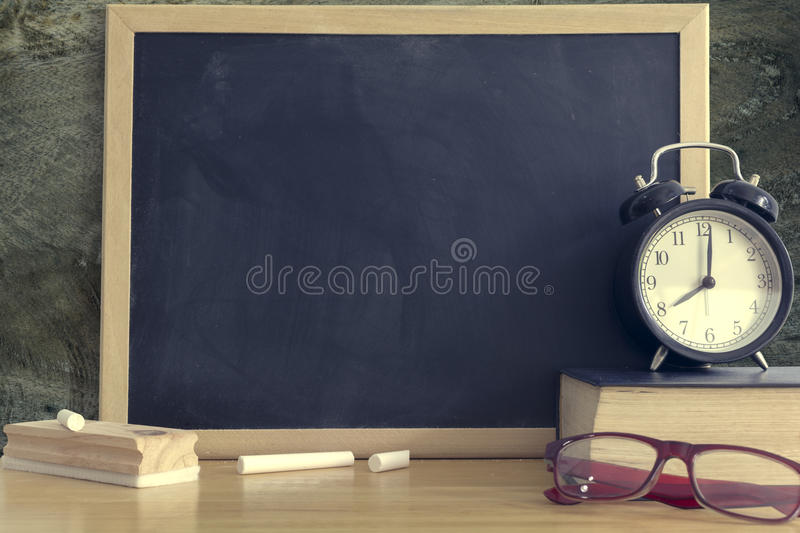 Chalkboard with wording Back to school and. Black board for display text or graphic design. Abstract background. Still life style. stock image