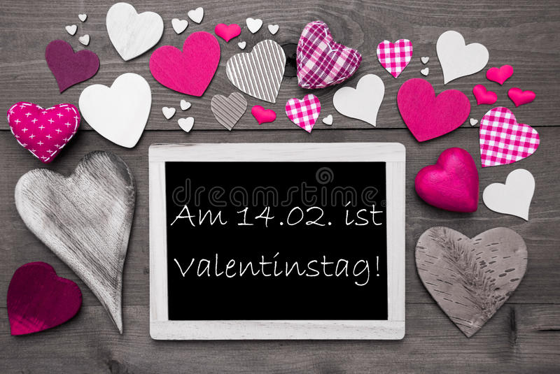 Chalkbord With Many Pink Hearts, Valentinstag Means Valentines Day. Chalkboard With German Text Valentinstag Means Valentines Day. Many Pink Textile Hearts. Grey stock images