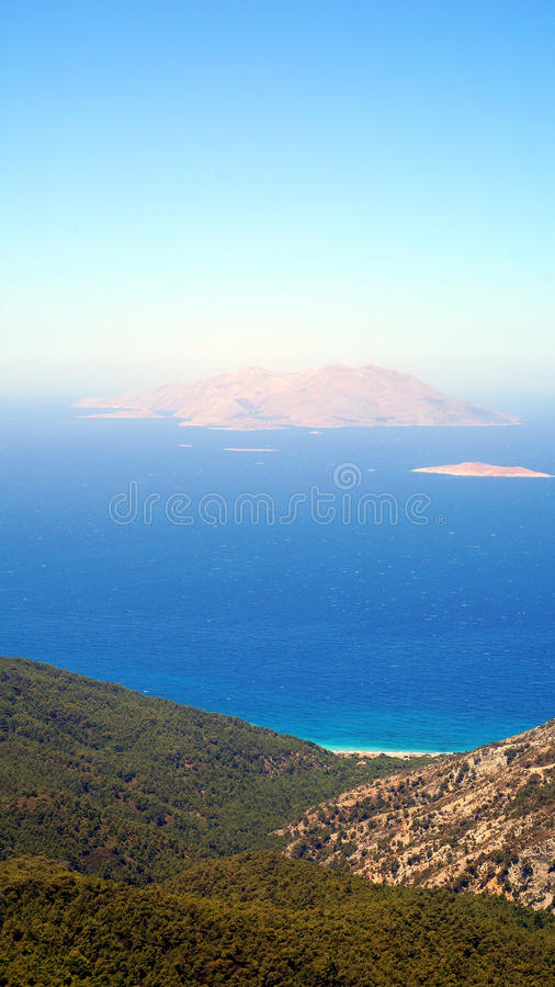Chalki view from Rhodos stock image