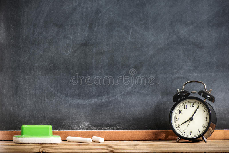 Chalks And Blackboard With Alarm Clock. Education And Time Management Concept royalty free stock image
