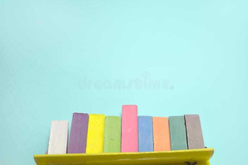 Chalks for drawing colored set take out from the open cardboard royalty free stock photos