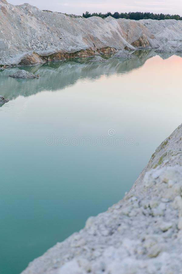 Mountain lake with emerald water at sunset royalty free stock photography