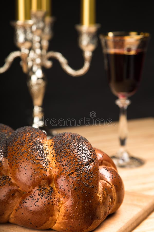 Challah Bread, Candelabrum and Wine For Shabbat. Candelabrum shabbat challah jewish food religion bread wine royalty free stock photos