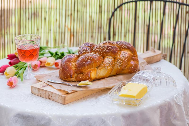 Challah bread on round table served with Amber wine royalty free stock photography
