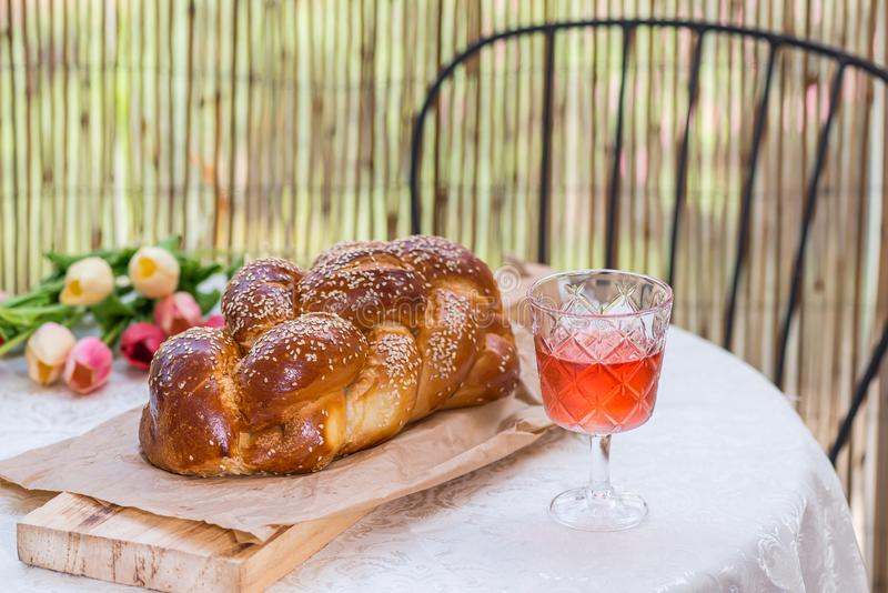 Challah bread on round table served with Amber wine royalty free stock photo