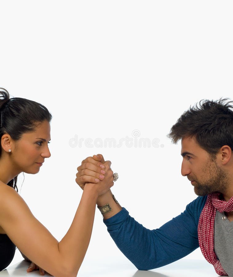Challenge. The battle of sexes, arm wrestling couple stock image