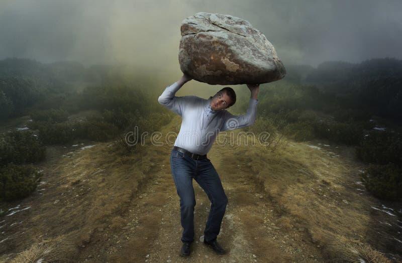 Challenge concept. Man with boulder. Man with big boulder on top of him stock images