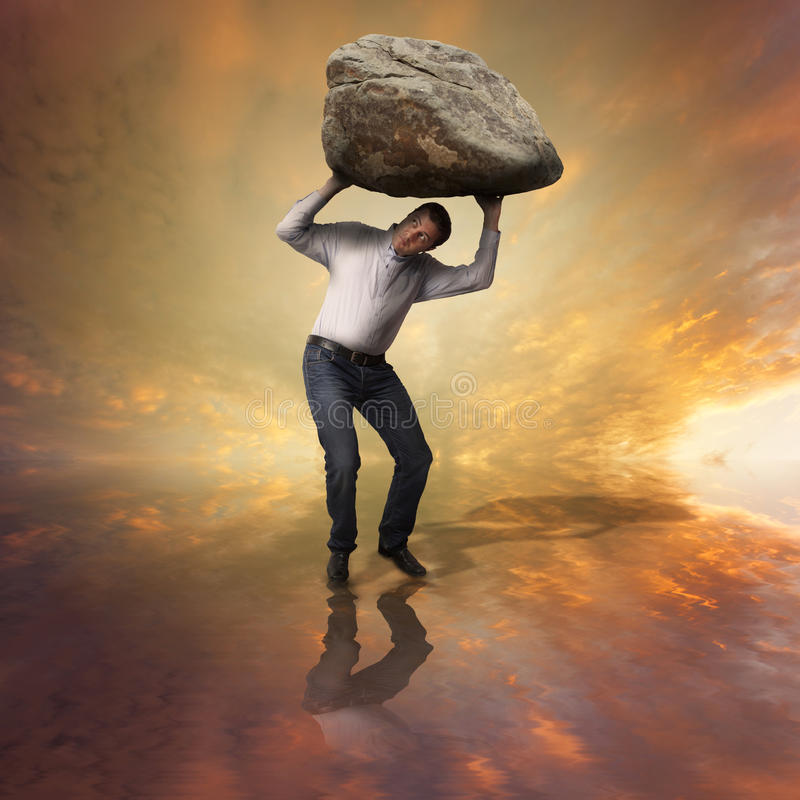 Challenge concept. Man with boulder. Man with big boulder on top of him royalty free stock images