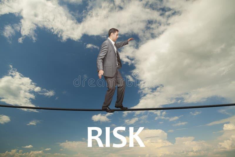 Challenge concept. Man walking on wire. Man walking on wire. Challenge concept: difficult stock photo