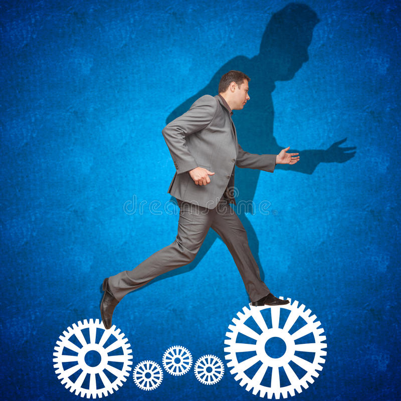Challenge concept. Taking risks. Business man jumping from one side to another. Challenge concept: difficult stock photos