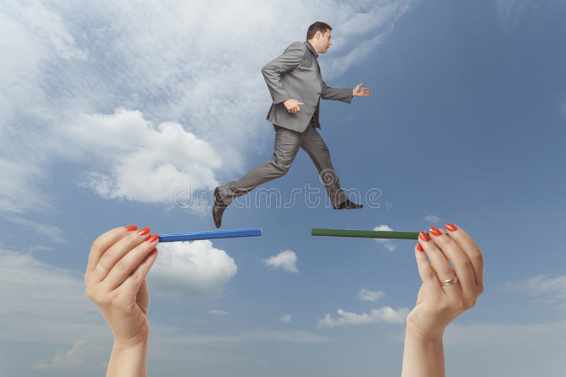 Challenge concept. Taking risks. Business man jumping from one side to another. Challenge concept: difficult stock photography