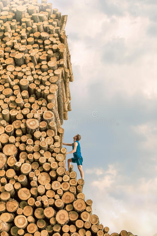 Free Challenge Man Climbing The Large Pile Of Logs Royalty Free Stock Images - 29006489