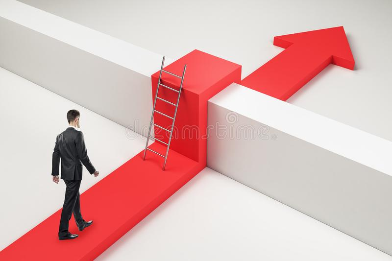 Challenge and obstacle concept. Businessman with red arrow going over concrere fence. Challenge and obstacle concept royalty free stock image