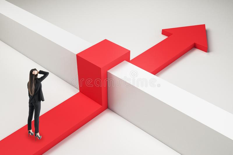 Challenge and overcome concept. Thoughtful businesswoman with red arrow going over concrere fence. Challenge and overcome concept stock images