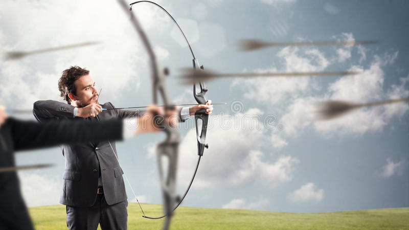 Challenge for reach and hit new business targets. Businessmen in a competition with the arc and arrows to reach and hit new targets stock photography