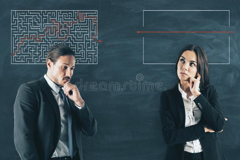 Challenge and solution concept. Businessman and women with maze sketch on chalkboard background. Challenge and solution concept stock photo