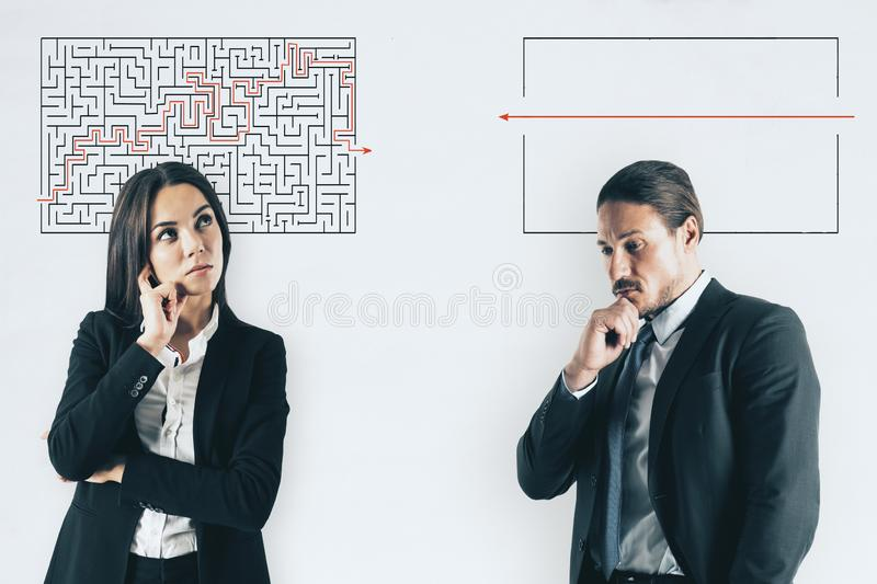 Challenge and solution concept. Businessman and women with maze sketch on white background. Challenge and solution concept stock image