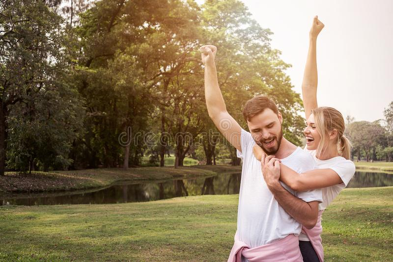 Challenge success couple raising hands for fitness goal achievement. Athletes couple cheering hands. Outdoors sports lifestyle with copy space stock photography