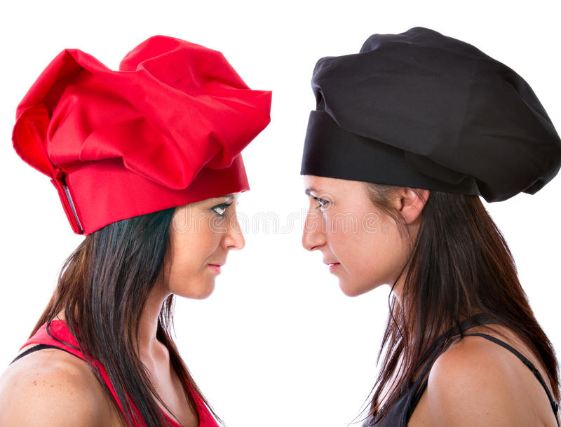 Challenge between women chefs. White background stock images