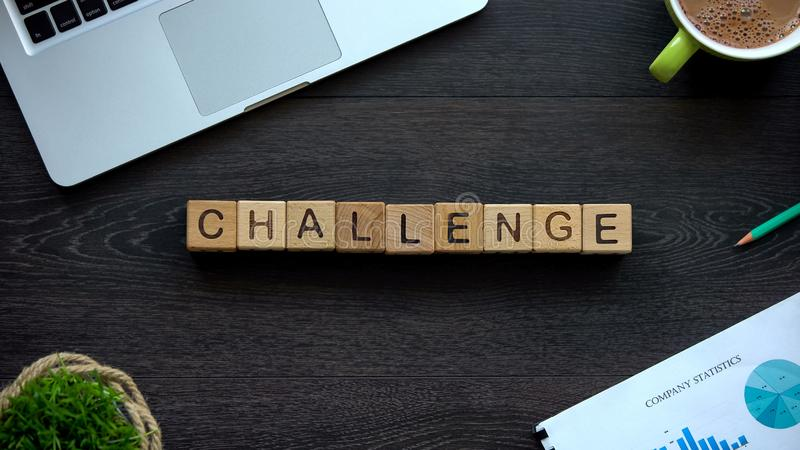 Challenge word made of cubes, overcoming difficulties to goals achievement stock photos