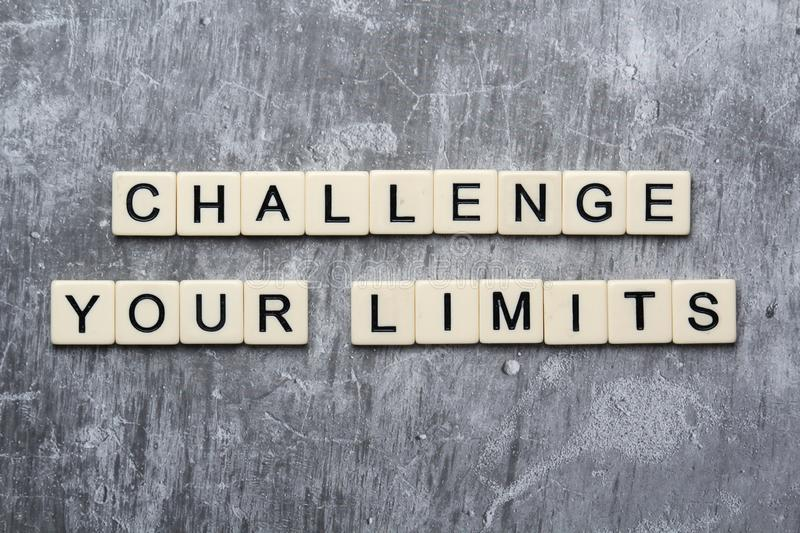 Challenge your limits motivational phrase stock image
