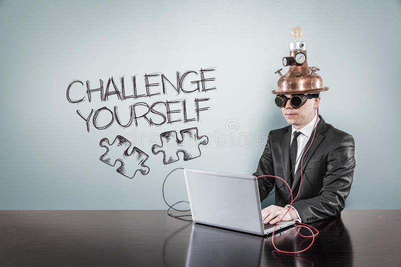 Challenge yourself text with vintage businessman using laptop. At office royalty free stock photos