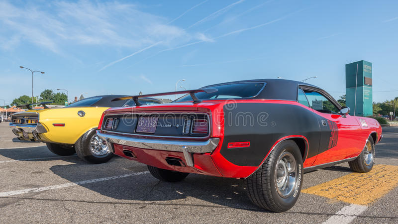 Challenger and 'Cuda at the Woodward Dream Cruise. ROYAL OAK, MI/USA - AUGUST 15, 2014: Dodge Challenger and Plymouth 'Cuda (Barracuda) cars at the Woodward royalty free stock image