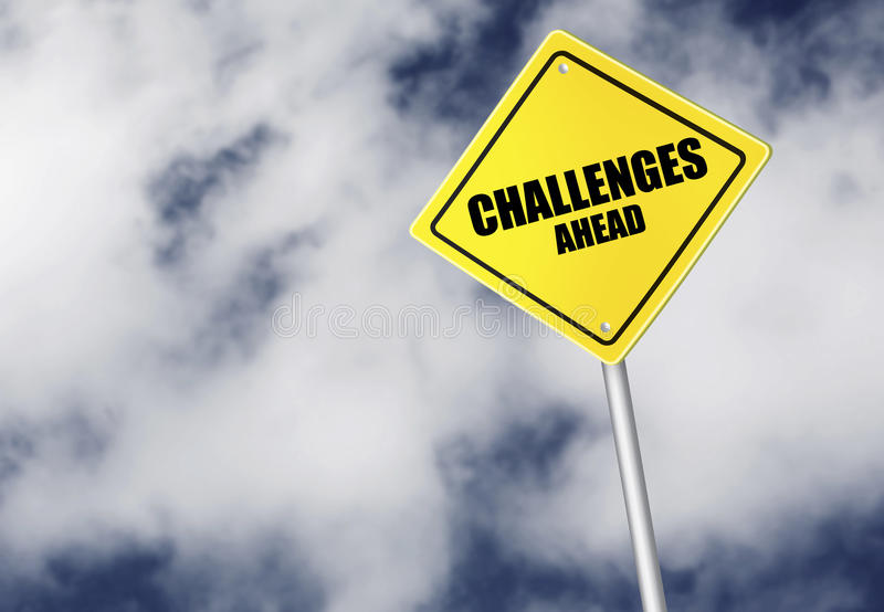 Challenges ahead sign. Over cloudy sky royalty free stock image