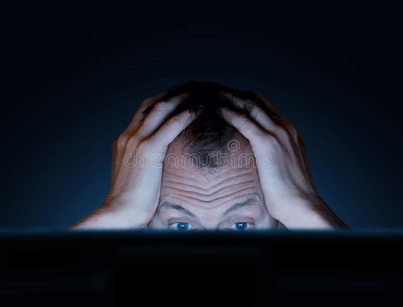 Challenges of working at a computer. In dark stock images