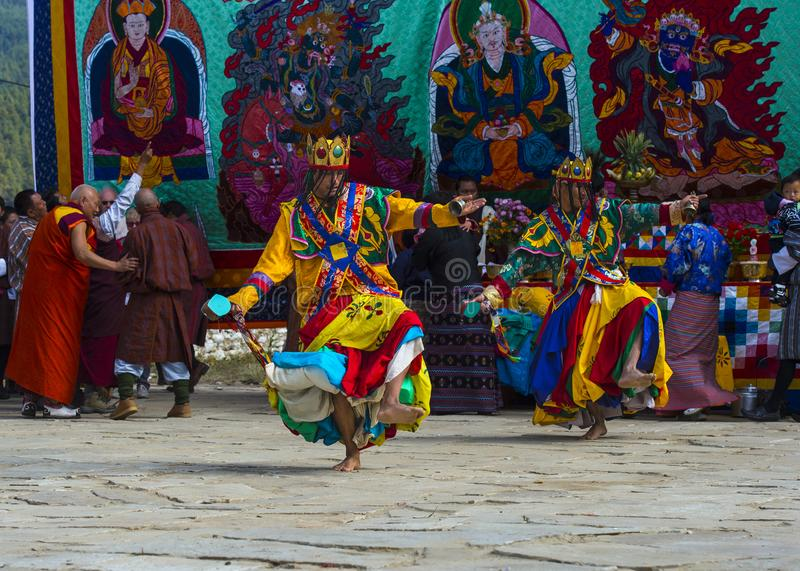 Cham dance , two dancers move in an intricate series of steps , Bumthang , central Bhutan. The main forms of dance are spectacular and theatrical masked dances royalty free stock images