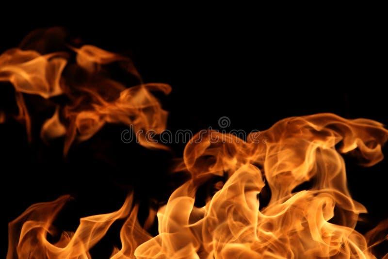 chama de queimadura no fundo escuro para a finalidade abstrata do projeto gráfico fotos de stock royalty free