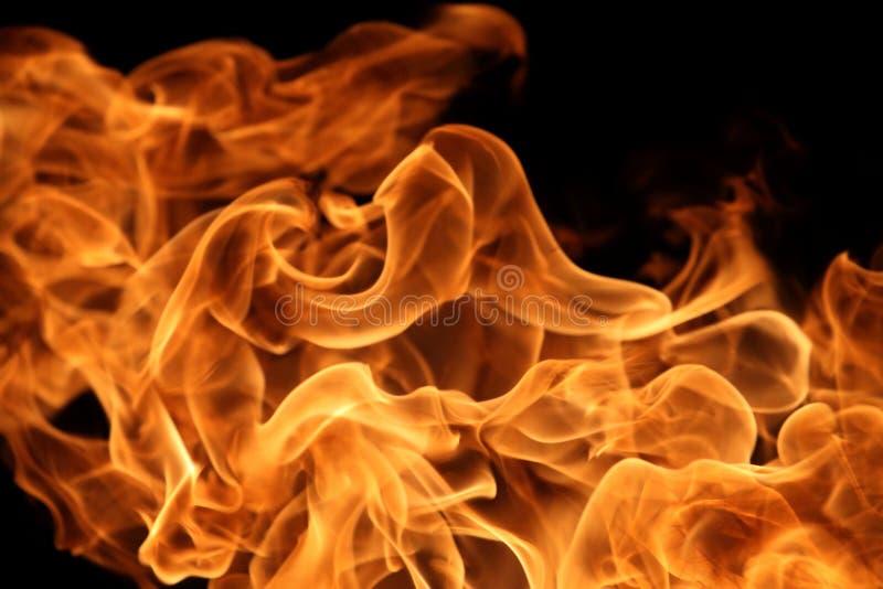 Chama de queimadura no fundo escuro para o projeto gráfico abstrato fotos de stock royalty free